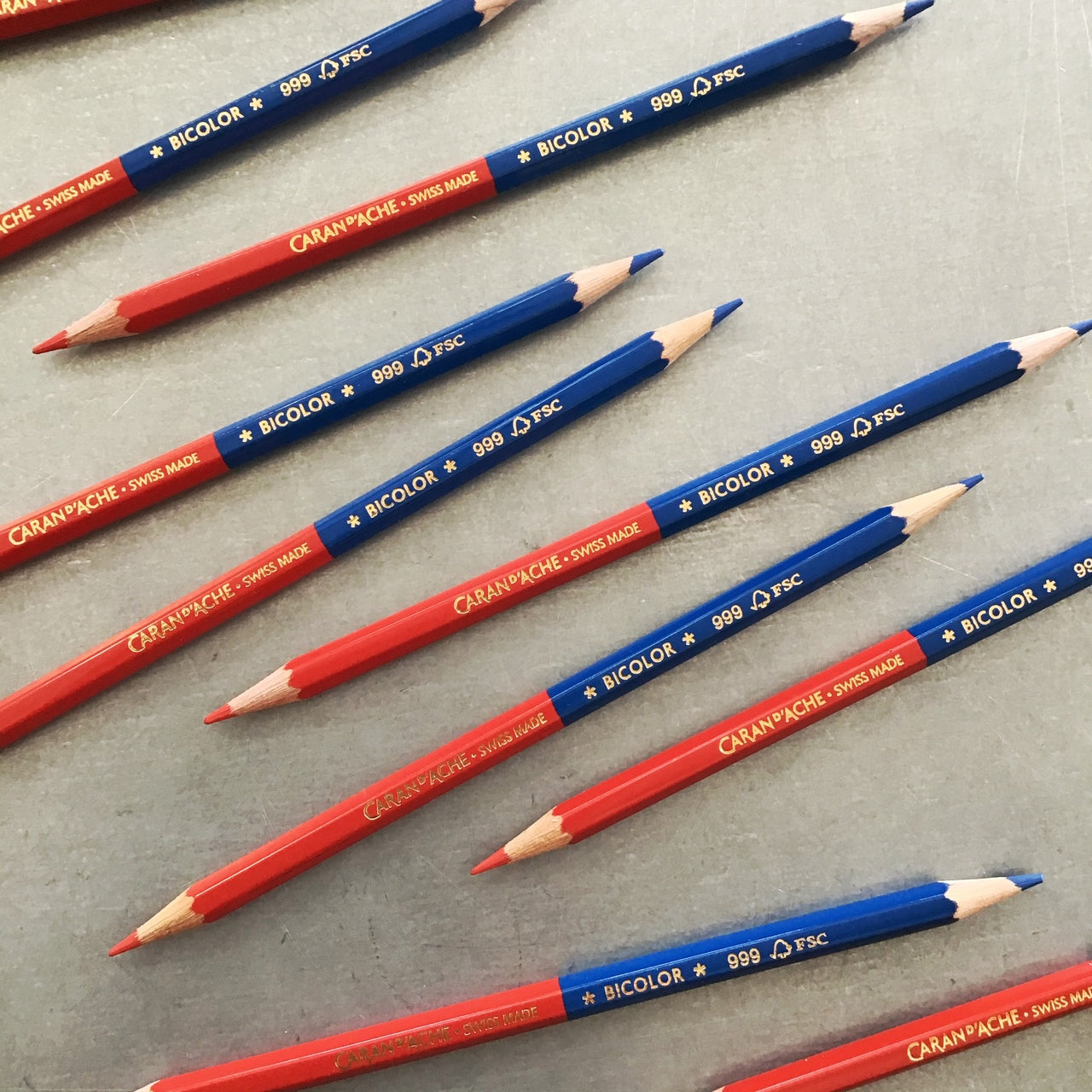 Caran d'Ache bicolor pencil is available as single pencil or in a box of 12.