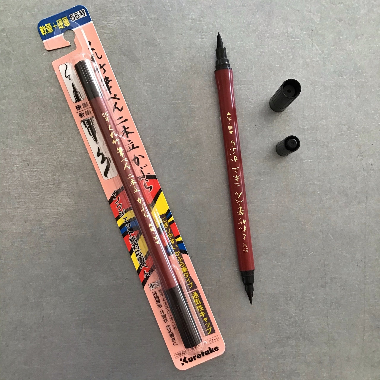 The Kuretake Fude double-sided brush pen, or Nihondate Kabura (No.55), contains a water-based dye Ink.