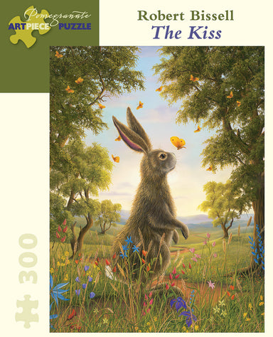 "Ready for a manageable, 300 piece puzzle. ""The Kiss"", by Robert Bissell, shows a rabbit surrounded by green trees and rolling hills."