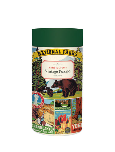 Cavallini & Co. National Parks 1000 piece puzzle features their National Parks Decorative wrap, a collage of vintage National Parks logos and designs.