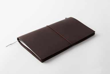 The Regular Size Brown Midori Traveler's Notebook Starter Kit comes with a handmade, cowhide leather cover.