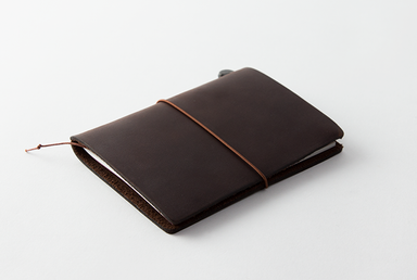 Midori Traveler's Notebook- Passport Size- Brown is a travel size notebook that is customizable.