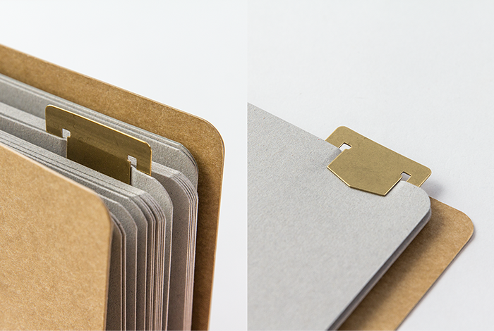 The Alphabet Brass Bookmark can mark the pages of your Midori Traveler's Notebook.
