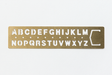 The Midori Traveler's Notebook Alphabet Brass Bookmark will change over time as you use it, making it more personalized.