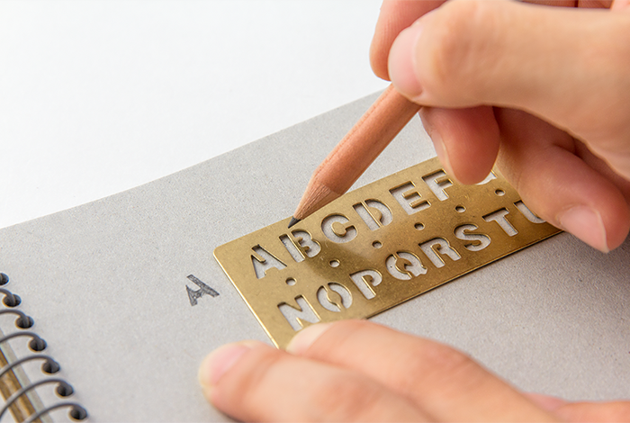 Use the Midori Traveler's Notebook Alphabet Brass Bookmark to make clear letters.