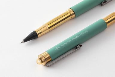 The rollerball pen design uses a tiny revolving ball to dispense liquid ink onto paper.