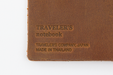 Each Camel Midori Traveler's Notebook is branded with the logo and make information.