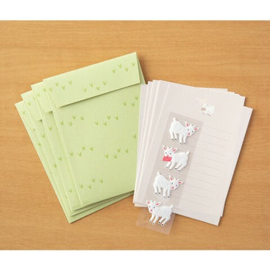 Each set has 4 sheets of paper measuring approximately 4 by 5 1/2 inches, along with four envelopes, and four goat stickers.