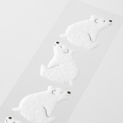 Set includes four fluffy white polar bear stickers for envelope sealing.