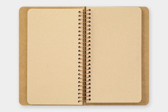Spiral Ring Notebook- Kraft Paper Vertical A6 Slim is bound with gold rings and features a cover made of hearty kraft stock ready and waiting for personalization.
