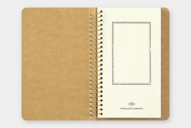Traveler's Company Spiral Ring Paper Pocket Notebook lies flat when open.
