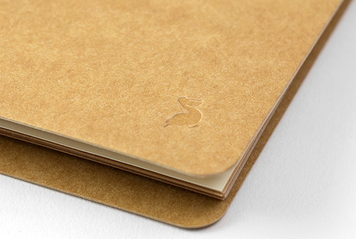 The Midori Spiral Ring Photo File features a cover made of hearty kraft stock ready for your personal decoration.