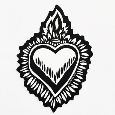 Two Hands Made Milagro Flaming Heart Vinyl Sticker- a heart to compliment any surface.