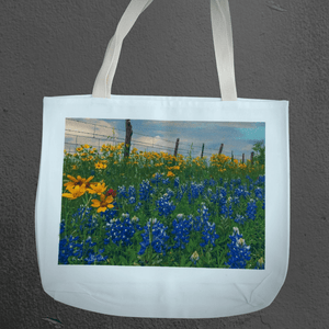 Texas Hill Country canvas tote bags | market bags | art bags | bluebonnets near fenceline | Texas wildflower photography | Shop original art by Texas artists at artasemotion.com | Boerne, San Antonio art gallery with original paintings, photography, and more