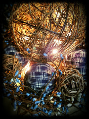 Close-up Large Rusty Pail Lighted Grapevine Balls Blue and Cream Homespun Balls