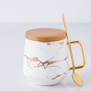 Porcelain Mug With Wooden Cover and Gold Spoon