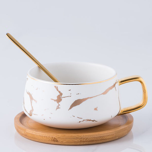 Porcelain Cup With Wooden Saucer and Gold Spoon