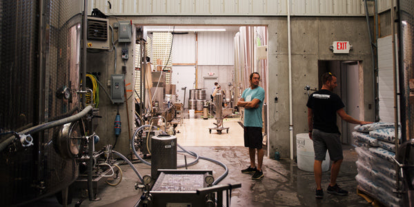 Employees working in Glacial Till's cider production facility