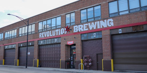 Outside of Revolution Brewing building in Chicago with loading docks and windows