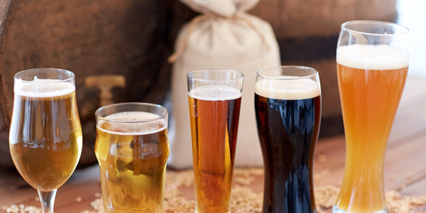 Different styles of beer in different types of beer glasses
