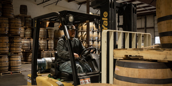 Warehouse worker operating a forklift at Midwest Barrel Co.
