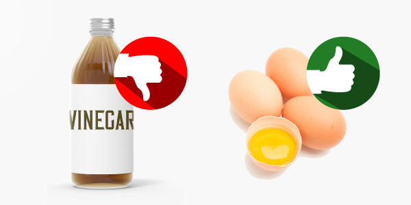 Bottle of vinegar with thumbs down image over it and four eggs, one sliced open, with thumbs up image over them.