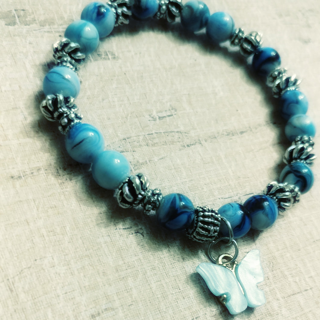 Shades of blue single charm butterfly bracelet