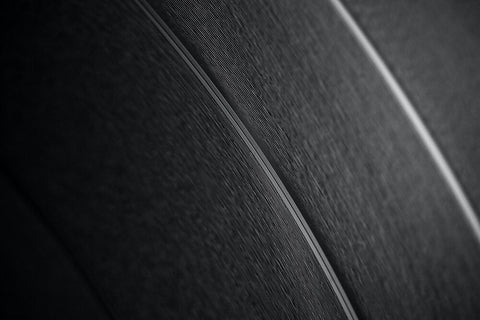 Close up of grooves in a vinyl reord.