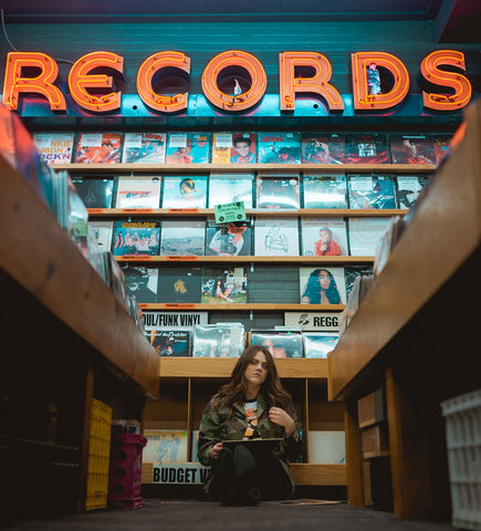 Girl in a vinyl record store.