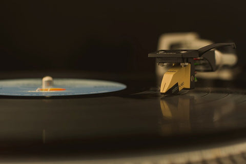 Stylus playing on a vinyl record