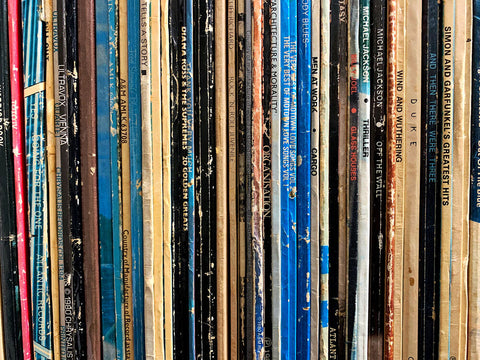 A stack of vinyl record albums