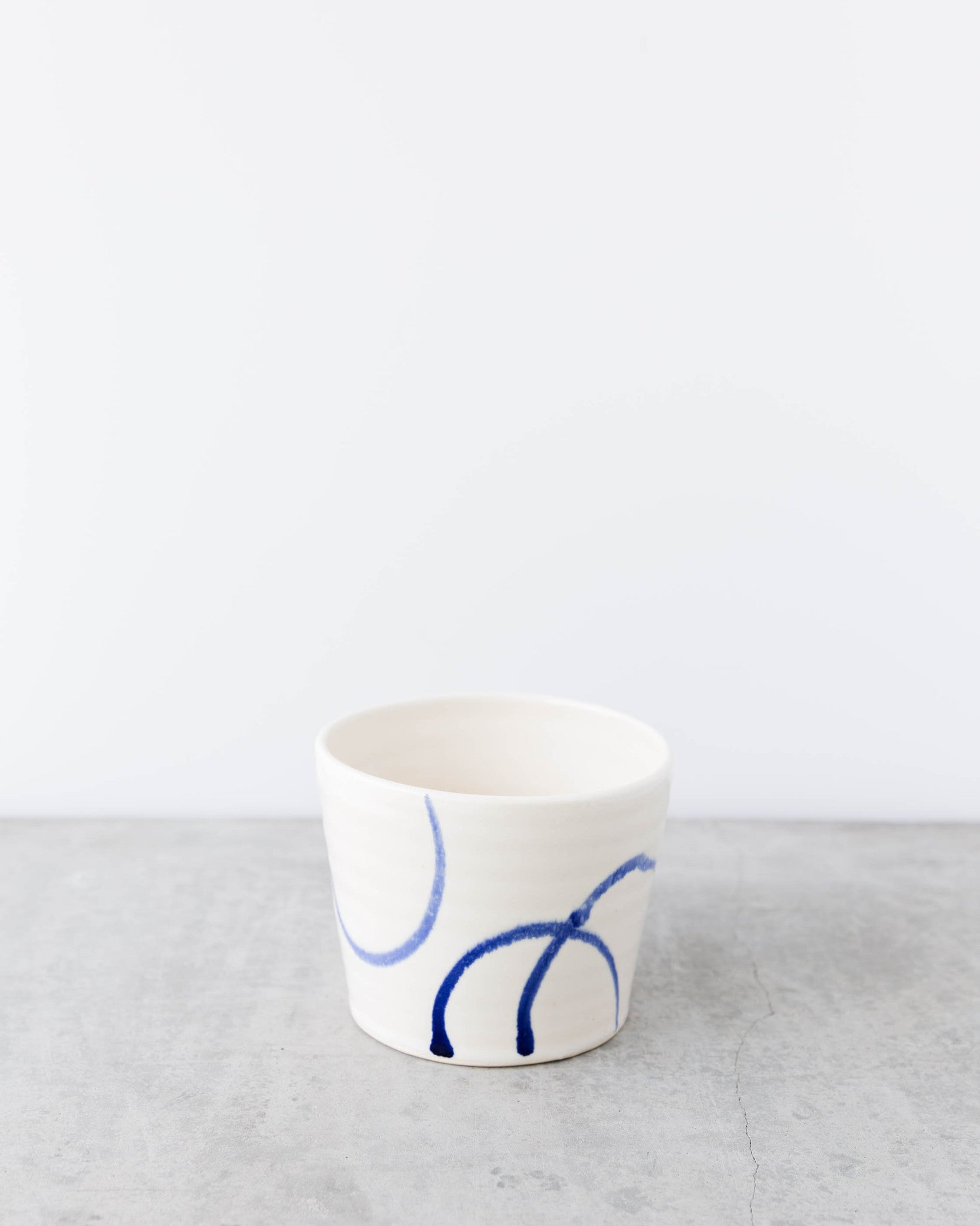 Kalika Bowlby White and Blue Circles Planter