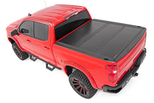 Load image into Gallery viewer, GM Low Profile Hard Tri-Fold Tonneau Cover (19-20 1500 | 5.8' Bed)