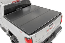 "Load image into Gallery viewer, GM Hard Tri-Fold Bed Cover (15-19 Chevy/GMC 2500/3500 - 6' 5"" Bed)"
