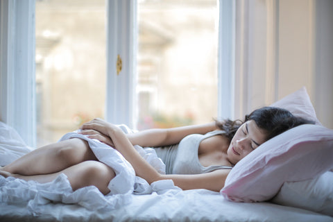 woman sleeping in the bed