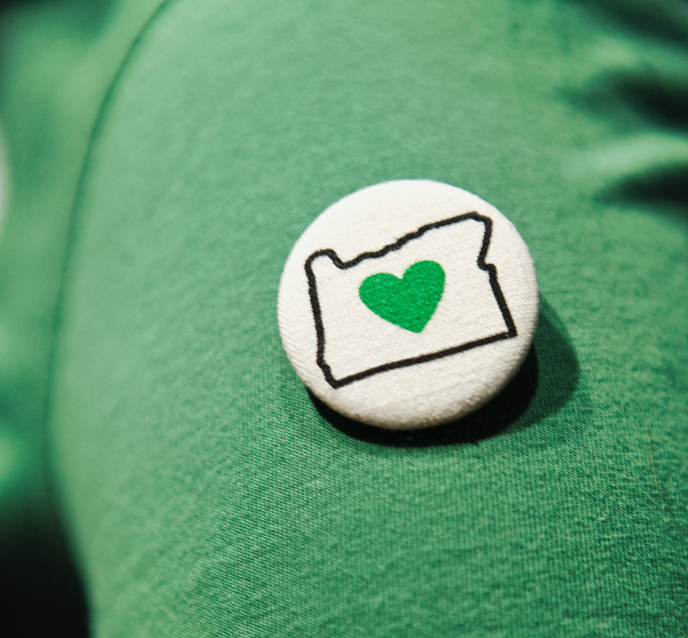 Heart in Oregon button on sleeve