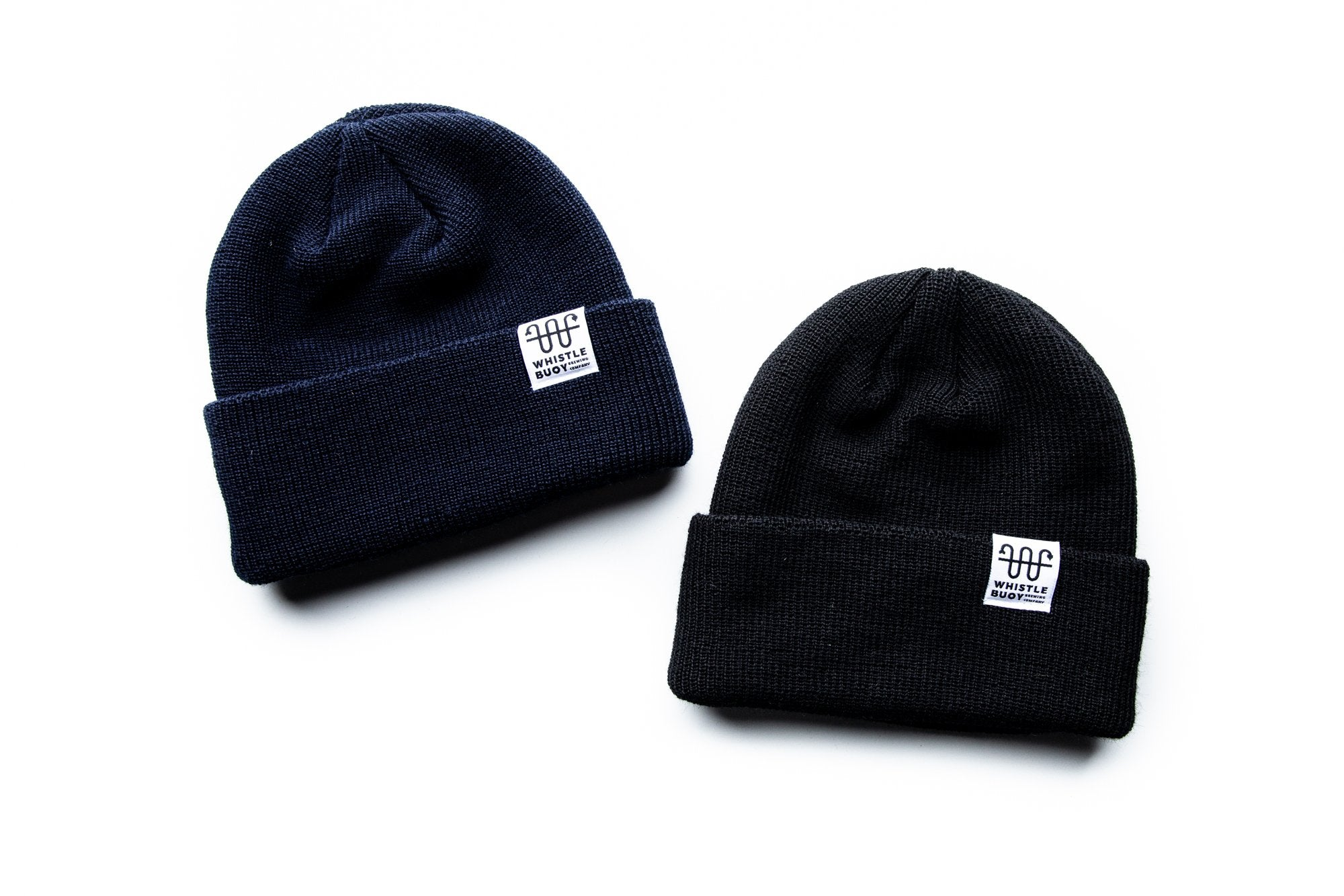 Two Whistle Buoy merino blend toques with white logo in blue and black