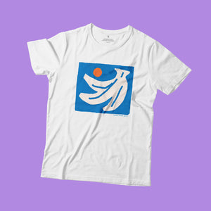 Open image in slideshow, A white t-shirt flat on lilac background. The print on the shirt is an off-white hand of bananas with an orange circle next to them on a blue square background.