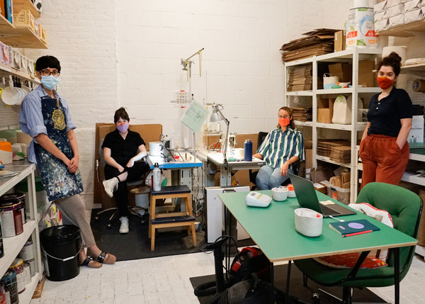 The Closed Mondays team of four in their colorful Brooklyn studio