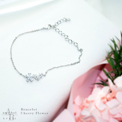 Reference cut of Korean fashion bracelet Cherry Flower in Silver Rhodium color in the white background.