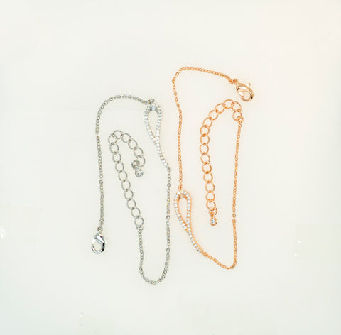Reference cut of Korean fashion bracelet Ribbon in 14KGP Rose Gold and Silver Rhodium placed in the white background.