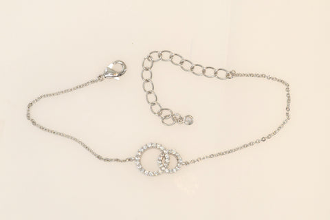 A detailed reference cut of Korean fashion bracelet Double Ring in Silver Rhodium color.