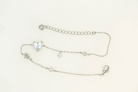 A reference cut of Korean fashion bracelet Heart Cubic in Silver Rhodium color in the white background.