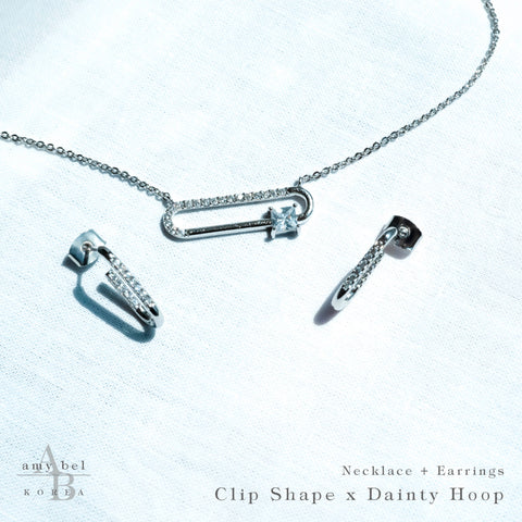Reference cut of Necklace Clip-shape and Earrings Dainty Hoop in Silver color on the white background.