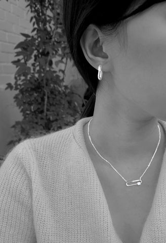 A model is wearing amy bel Korea Fashion earrings Dainty hoop and Clip Necklace in Silver Rhodium color.