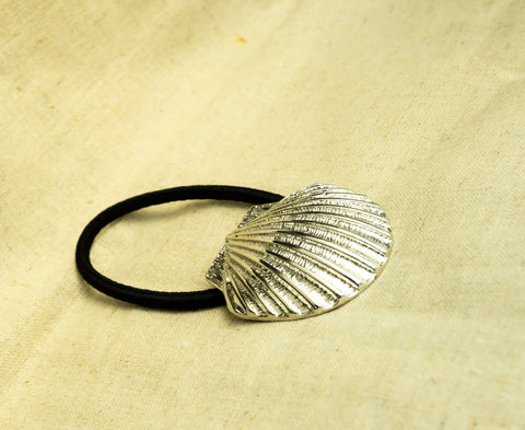 amy bel Korea hair accessory Hair tie band II (Whole Shell) in Silver color is placed in the sunlight.
