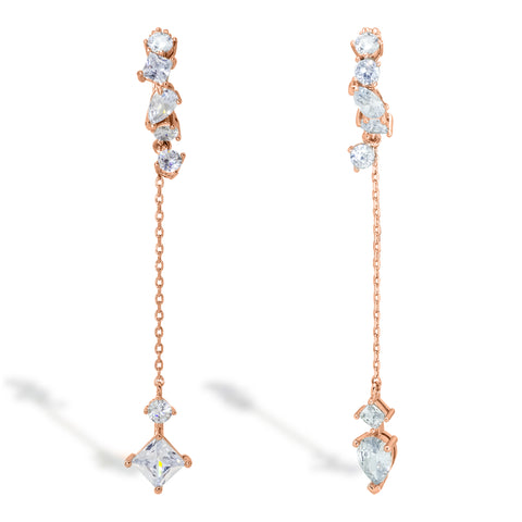 A set of Korean earrings Loona Tail in rose gold color with silver post stands on the white background
