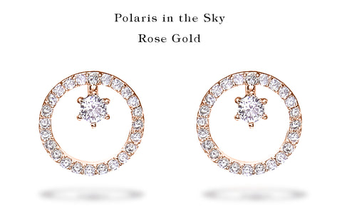 """A set of Korean earrings """"Polaris"""" in Rose Gold color stands on the white background."""