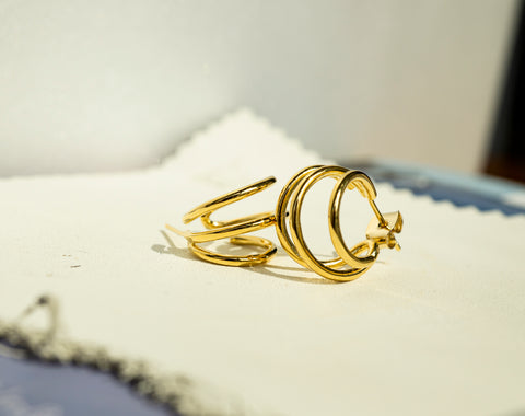 A set of Korean earrings Spiral Little Hoop in Gold color shows its detail.