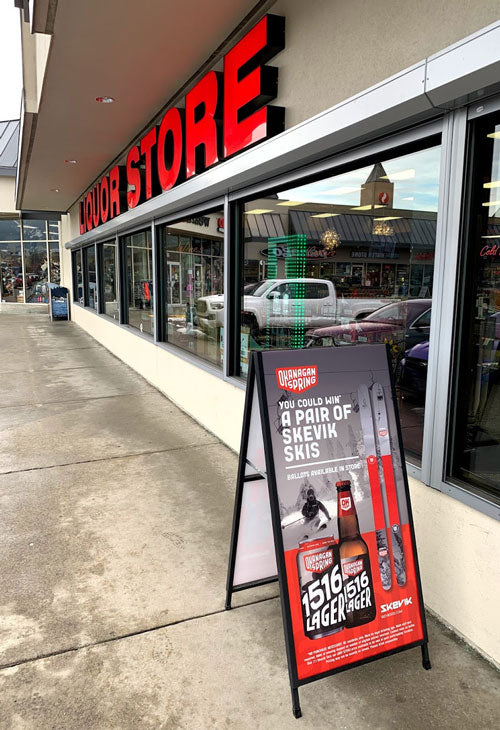 Outside the Vernon Square Liquor Store with poster display